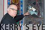 Rev Simon Lumby inspects the broken stained glass window in St Mary's Church of Ireland Killarney broken by vandals on Saturday night