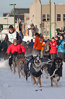 Musher Bob Storey and Iditarider Jedd Smith.leave the 2011 Iditarod ceremonial start line in downtown Anchorage, Alaska
