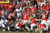 Seattle Seahawks defensive tackle Rocky Bernard (99) attempts to block a field goal in the first quarter but the kick by Lawrence Tynes (1) is good to give the Chiefs an early lead at Arrowhead Stadium  in Kansas City, Missouri on October 29, 2006. The Chiefs won 35-28.