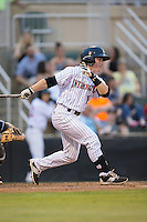 Bradley Strong (18) of the Kannapolis Intimidators follows through on his swing against the Asheville Tourists at Intimidators Stadium on May 28, 2016 in Kannapolis, North Carolina.  The Intimidators defeated the Tourists 5-4 in 10 innings.  (Brian Westerholt/Four Seam Images)
