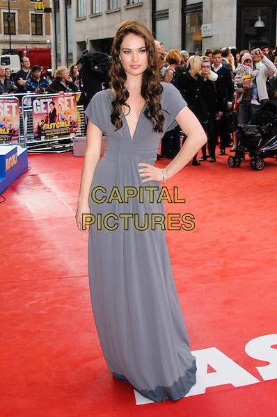 Lily James.UK film premiere of 'Fast Girls' at Odeon West End, London, England..June 7th, 2012.full length grey gray dress wet hem hand on hip.CAP/CJ.©Chris Joseph/Capital Pictures.