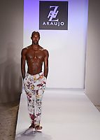 Phillip Evelyn walks runway at A.Z Araujo Swimwear Show during Mercedes Benz IMG Fashion Swim Week 2013 at The Raleigh Hotel, Miami Beach, FL on July 23, 2012