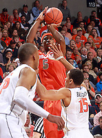 Syracuse forward C.J. Fair (5) shoots over Virginia guard Malcolm Brogdon (15) during an NCAA basketball game Saturday March 1, 2014 in Charlottesville, VA. Virginia defeated Syracuse 75-56.