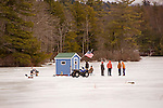 Group Enjoying Ice Fishing on Lake Warren in New Hampshire