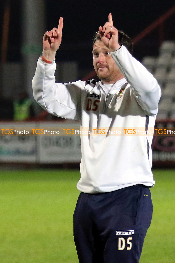 Stevenage Manager, Darren Sarll at the final whistle indicates to the fans that his team could be going up next season during Stevenage vs Bristol Rovers, Sky Bet League 2 Football at the Lamex Stadium on 19th April 2016