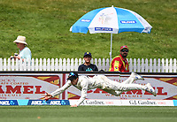 2nd December, Hamilton, New Zealand; Mitchell Santner divs to stop a 4 boundary while fielding on day 4 of the 2nd test cricket match between New Zealand and England  at Seddon Park, Hamilton, New Zealand.