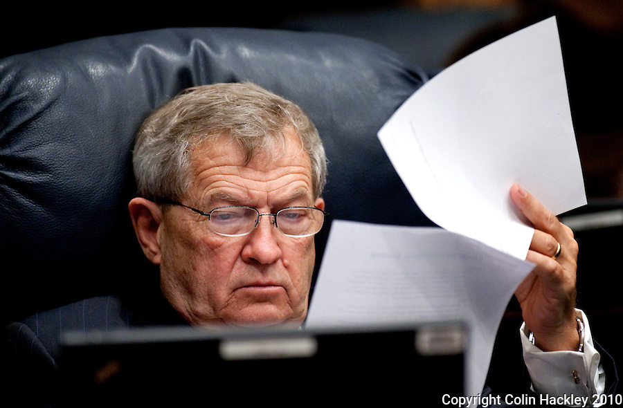 TALLAHASSEE, FLA. 3/2/10-OPENING DAY CH39-Sen. Michael Bennett, R-Bradenton, studies the unemployment compensation bill during debate on the topic, Tuesday at the Capitol in Tallahassee...COLIN HACKLEY PHOTO
