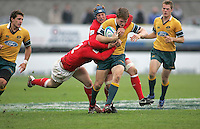 Australian centre Rowan Kellam is tackled by Welsh centre Rhys Williams and flanker Lloyd Phillips during the Division A 3rd/4th place clash at Ravenhill, Belfast. Result Australia 25 Wales 21.