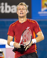 LLEYTON HEWITT (AUS) against MILOS RAONIC (CAN) in the third round of the Men's Singles. Lleyton Hewitt beat Milos Raonic 4-6 6-3 7-6 6-3..21/01/2012, 21st January 2012, 21.01.2012..The Australian Open, Melbourne Park, Melbourne,Victoria, Australia.@AMN IMAGES, Frey, Advantage Media Network, 30, Cleveland Street, London, W1T 4JD .Tel - +44 208 947 0100..email - mfrey@advantagemedianet.com..www.amnimages.photoshelter.com.