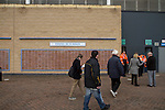 Coventry City 1 Birmingham City 1, 10/03/2012. Ricoh Arena, Championship. Home fans passing a 'Wall of Fame' dedicated to former home player Tommy Hutchinson outside the Ricoh Arena, pictured before Coventry City hosted Birmingham City in an Npower Championship fixture. The match ended in a one-all draw, watched by a crowd of 22,240. The Championship was the division below the top level of English football. Photo by Colin McPherson.