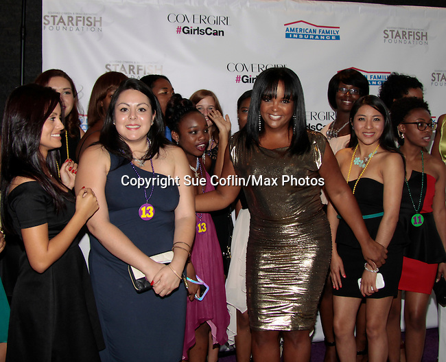 Kim Bondy (Mistress of Ceremonies) and the girls at Soledad O'Brien and Brad Raymond Starfish Foundation presents New Orleans to New York City 2014 Gala on July 24, 2014 at Espace, New York City for VIP Cocktail Reception, dinner, entertainment with Grammy Award winning Trumpeteer Irvin Mayfield (also Board president) and the New Orleans Jazz Orchestra. (Photo by Sue Coflin/Max Photos)