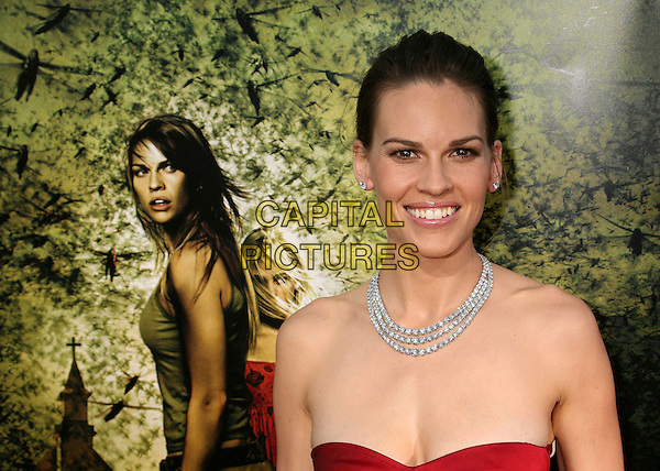 """HILARY SWANK.""""The Reaping"""" Los Angeles Premiere at Mann's Village Theatre, Hollywood, California, USA, 29 March 2007..portrait headshot poster red strapless dress.CAP/ADM/BP.©Byron Purvis/AdMedia/Capital Pictures."""