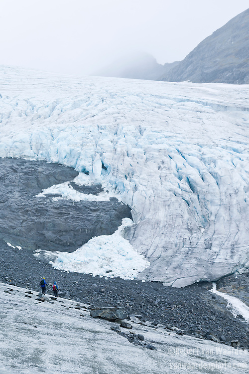 Two figures descend the tongue of the Storbreen Glacier in Norway's Jotunheimen National Park. As part of their field studies, CryoEx international exchange students, including Robert Way of the University of Ottawa, learned techniques to determine the current mass balance of the glacier and the pattern of its retreat over time.