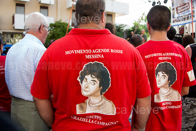 "Palermo (Sicily - Italy), 19/07/2017. ""Basta depistaggi e omertà di Stato!"" (""Stop disinformation and omertá by the State!"") (1). Public event to commemorate the 25th Anniversary of the assassination of the anti-mafia Magistrate Paolo Borsellino along with five of his police ""scorta"" (Escorts from the special branch of the Italian police force who protect Judges): Agostino Catalano, Emanuela Loi (The first Italian female member of the police special branch and the first woman of this branch to be killed on duty), Vincenzo Li Muli, Walter Eddie Cosina and Claudio Traina. The event was held at Via D'Amelio, the road where Borsellino was killed. Family members of mafia victims, amongst others, made speeches about their dramatic experiences, mafia violence and unpunished crimes, State cover-ups, silence ('omertá'), and misinformation. Speakers included, amongst others, Vincenzo Agostino & Augusta Schiera, Salvatore & Cristina & Antonella Catalano, Graziella Accetta & Ninni Domino, Massimo Sole, Paola Caccia, Luciano Traina, Gianluca & Angela Manca, Nunzia & Stefano Mormile, Ferdinando Imposimato, Judge Nino Di Matteo. The event ended with the screening of the RAI docu-fiction, 'Adesso Tocca A Me' ('Now it's My Turn' - Watch it here: http://bit.ly/2w3WJUX ) by G. Filippetto & F. Miccichè.<br />
