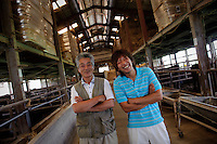 CEO Kazutaka stands in a cow shed with his son Yuta Seto at Maruse Stockbreeding Inc, Hyogo Prefecture, Japan, June 25, 2009.