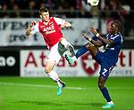 Nederland, Alkmaar, 20 oktober  2012.Eredivisie.Seizoen 2012-2013.AZ-N.E.C..Leroy George van N.E.C. in duel om de bal met Johann Berg Gudmundsson van AZ