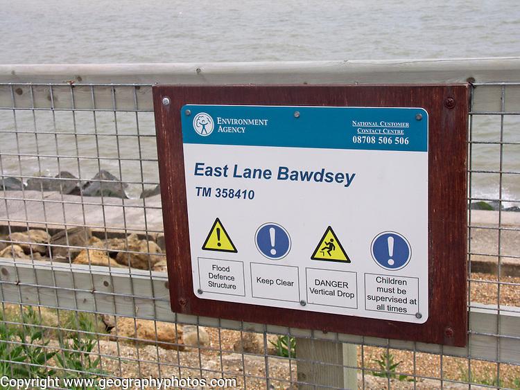 Environment Agency sign, coastal defences, East Lane, Bawdsey, Suffolk, England