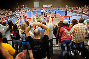 Fans cheer for their team during a bout between the Hellcats and Putas del Fuego at Palmer Events Center in Austin, Texas.