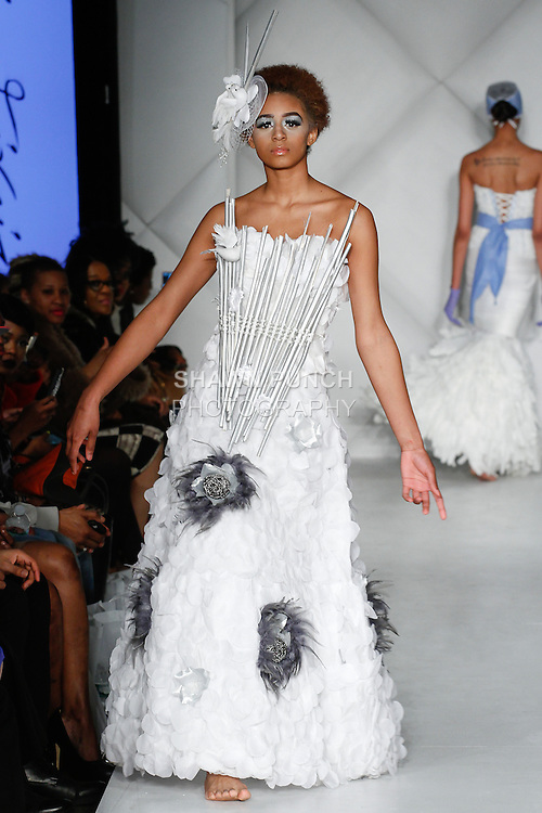 """Model walks runway in an out from the Lina Teixeira Fall 2014 """"Something Burrowed"""" Bridal collection, during Fashion Week Brooklyn Fall Winter 2014, at Industry City, on March 16, 2014."""