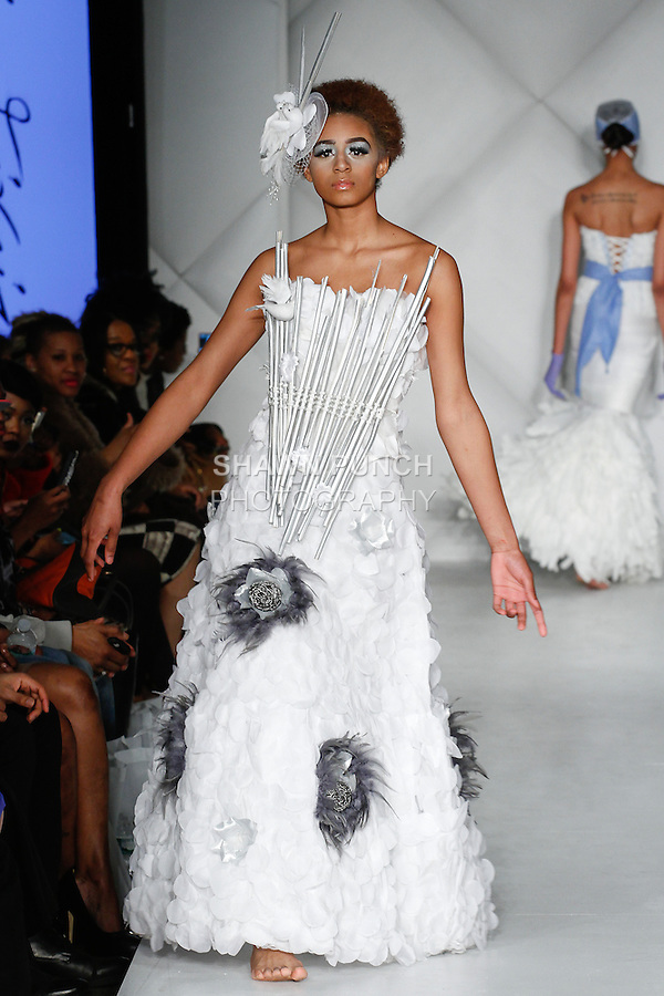 "Model walks runway in an out from the Lina Teixeira Fall 2014 ""Something Burrowed"" Bridal collection, during Fashion Week Brooklyn Fall Winter 2014, at Industry City, on March 16, 2014."