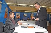 Doctor Mahdi S. Abdullah, M.D., of Mount Vernon, New York , right, receives his ballot and instructions from Jay Mehta, left, a ballot officer, in New Carollton, Maryland on January 28, 2005.  Doctor Abdullah is voting in the the Iraqi election.  Doctor Abdullah, a Baghdad-born internist, fled Iraq in 1993 after several of his relatives were killed by Saddam Hussein's regime.  He expressed joy at voting in the first free Iraqi election during his lifetime..Credit: Ron Sachs , CNP..(RESTRICTION: NO New York or New Jersey Newspapers or newspapers within a 75 mile radius of New York City)
