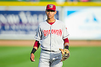 Orlando Arcia (2) of the Wisconsin Timber Rattlers warms up in the outfield prior to the game against the Great Lakes Loons at the Dow Diamond on May 4, 2013 in Midland, Michigan.  The Timber Rattlers defeated the Loons 6-4.  (Brian Westerholt/Four Seam Images)
