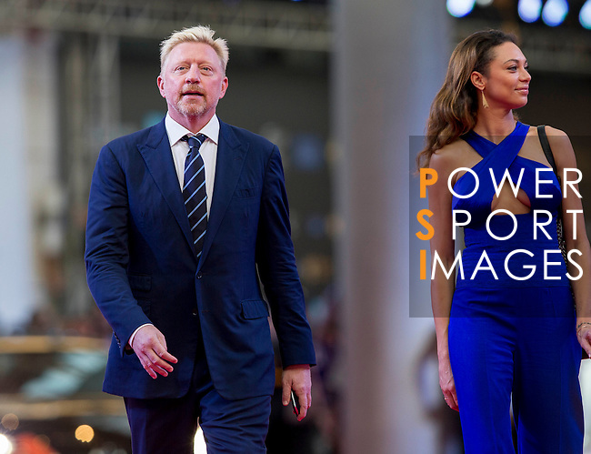 Boris Becker and his wife Sharely walk the Red Carpet event at the World Celebrity Pro-Am 2016 Mission Hills China Golf Tournament on 20 October 2016, in Haikou, China. Photo by Victor Fraile / Power Sport Images