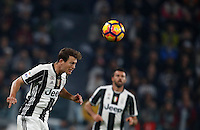 Calcio, Serie A: Juventus Stadium. Torino, Juventus Stadium, 29 ottobre 2016.<br /> Juventus&rsquo; Stephan Lichsteiner heads the ball during the Italian Serie A football match between Juventus and Napoli at Turin's Juventus Stadium, 29 October 2016. Juventus won 2-1.<br /> UPDATE IMAGES PRESS/Isabella Bonotto