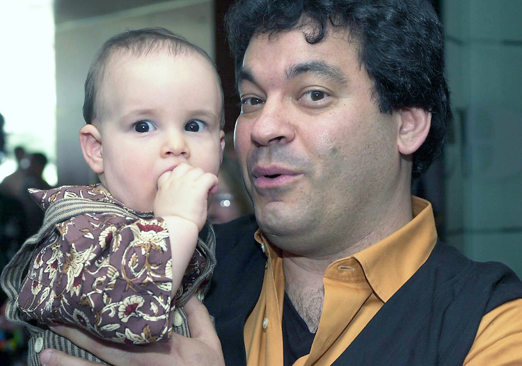 Ari Mintz with son Julian seen in the city room of Newsday on April 17, 2005. Photo by Jin Peppler.