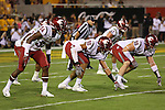 Jalen Thompson (34), Nnamdi Oguayo (30) and Garrett McBroom (99) await the snap at the line of scrimmage during the Cougars Pac-12 Conference road victory over the Arizona State Sun Devils, 37-32, on October 22, 2016, at Sun Devil Stadium in Tempe, Arizona.
