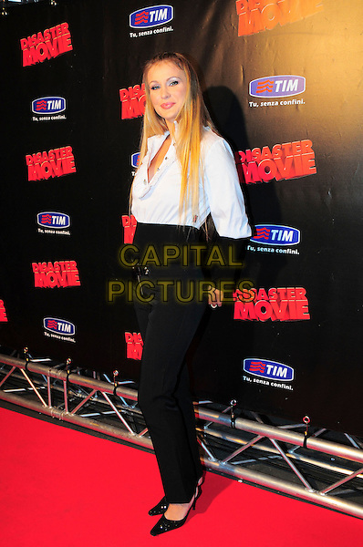 "EVA HENGER .Italian Film Premiere for ""Disaster Movie"" in Rome, Italy, October 8th 2008..full length black trousers blue shirt belt shoes waistband .CAP/CAV.©Luca Cavallari/Capital Pictures"