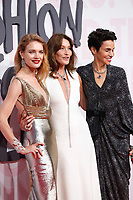 Natalia Vodianova, Carla Bruni and Farida Khelfa attend Fashion for Relief Cannes 2018 during the 71st annual Cannes Film Festival at Aeroport Cannes Mandelieu on May 13, 2018 in Cannes, France.F<br /> CAP/GOL<br /> &copy;GOL/Capital Pictures