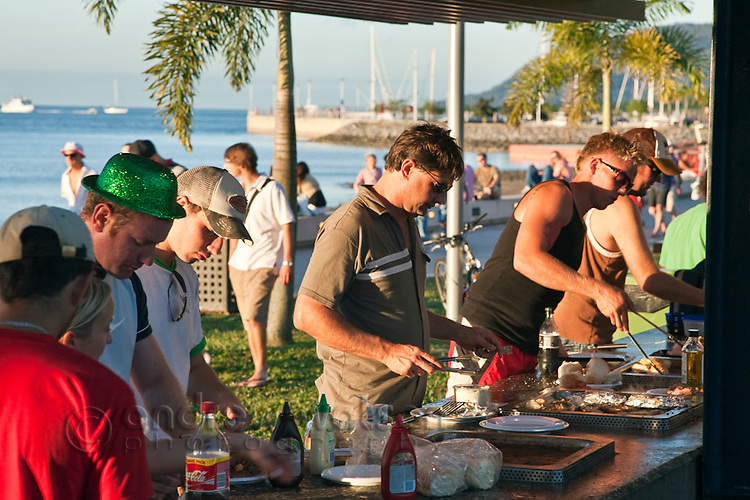 Tourists having a barbeque on the Esplanade.  Cairns, Queensland, Australia