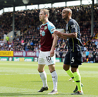 Burnley's Ashley Barnes and Manchester City's Vincent Kompany<br /> <br /> Photographer Rich Linley/CameraSport<br /> <br /> The Premier League - Burnley v Manchester City - Sunday 28th April 2019 - Turf Moor - Burnley<br /> <br /> World Copyright © 2019 CameraSport. All rights reserved. 43 Linden Ave. Countesthorpe. Leicester. England. LE8 5PG - Tel: +44 (0) 116 277 4147 - admin@camerasport.com - www.camerasport.com
