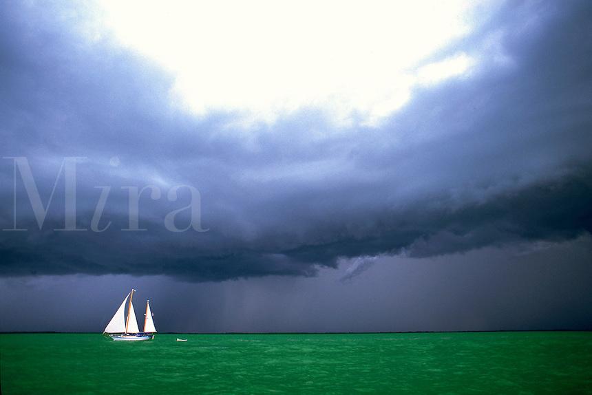 Dramatic view of a sailboat during a storm at sea. Florida Keys.