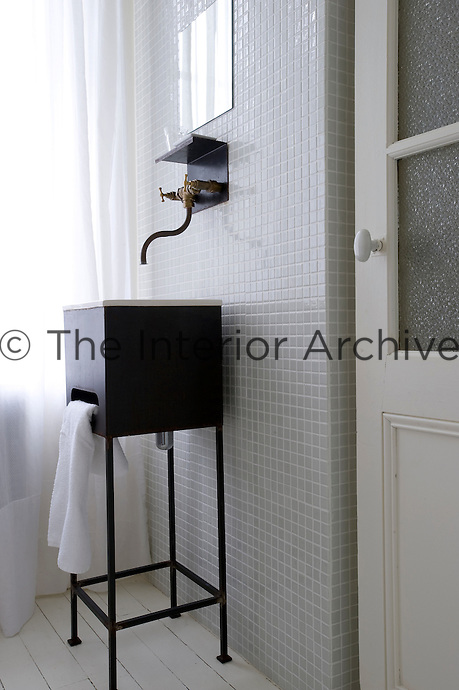 The contemporary bathroom has been decorated with grey mosaic tiles