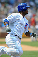 Chicago Cubs third baseman Luis Valbuena #24 runs to first  during a game against the Arizona Diamondbacks at Wrigley Field on July 15, 2012 in Chicago, Illinois. The Cubs defeated the Diamondbacks 3-1. (Tony Farlow/Four Seam Images).