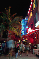 Neon lit sidewalk scene, Colony Hotel, South Beach, Miami, Florida