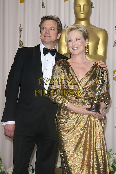 Colin Firth, Meryl Streep.84th Annual Academy Awards held at the Hollywood & Highland Center, Hollywood, California, USA..February 26th, 2012.oscars half length black tuxedo gold dress dress award trophy winner.CAP/ADM.©AdMedia/Capital Pictures.