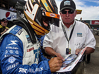 LEXINGTON, OH - SEPTEMBER 17:  Scott Pruett signs an autograph before  the EMCO Gears Classic at Mid-Ohio Sports Car Course on September 17, 2011 in Lexington, Ohio.  (Photo by Brian Cleary/bcpix.com)