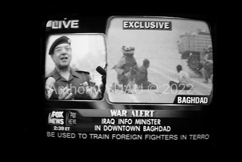 Madison, Wisconsin.USA.April 7, 2003..Baghdad Bob - Mohammed Saeed Al-Sahaf, Saddam Hussein's Minister of Information claims USA troops are not in Baghdad when at the same time images of US troops on the Baghdad parade grounds are shown on the FOX News channel..