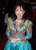 Country singer Loretta Lynn wears her ribbon as she arrives at the John F. Kennedy Center for the Performing Arts gala, December 7, 2003 in Washington, DC . Lynn joins actress Carol Burnett , soul singer James Brown , director Mike Nichols and violinist Izthak Perlman as the 2003 Honorees for their lifetime achievements in the arts.