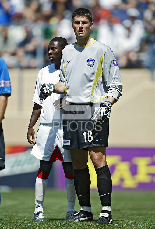 San Jose Earthquakes goalkeeper Pat Onstand towers over DC United's Freddie during their MLS match on May 1, 2004 at Spartan Stadium in San Jose, California.