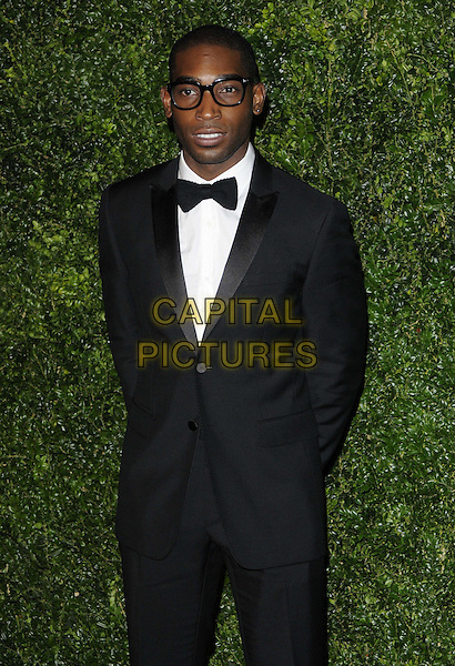 Tinie Tempah ( Patrick Chukwuemeka Okogwu ).The 58th London Evening Standard Theatre Awards in association with Burberry, Savoy Hotel, The Strand, London, England..November 25th, 2012.half length black tuxedo white shirt glasses .CAP/CAN.©Can Nguyen/Capital Pictures.