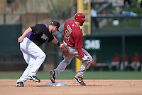 Eric Chavez of Diamondbacks and Reid BrignAC ,during   Colorado Rockies vs Arizona Diamondbacks, game of  Cactus league and Spring Trainig 2013..Salt River Fields stadium in Arizona. February 24, 2013