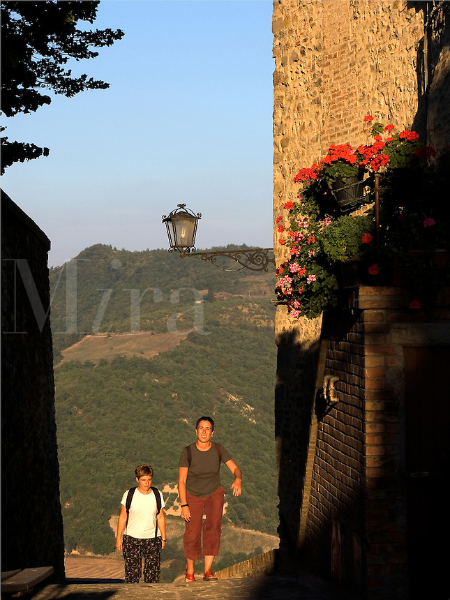 Lisa and Nina climbing path in the Umbrian hilltown of Montone Ital