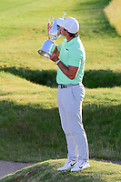 Brooks Koepka (USA) kisses the trophy for winning the 117th U.S. Open, at Erin Hills, Erin, Wisconsin. 6/18/2017.<br /> Picture: Golffile | Ken Murray<br /> <br /> <br /> All photo usage must carry mandatory copyright credit (&copy; Golffile | Ken Murray)