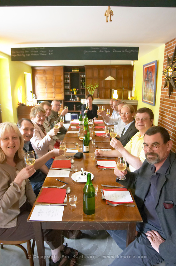 wine tasting in a restaurant group of people enjoying a meal restaurant le bistrot crozes hermitage rhone france