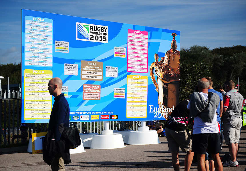 Fans gather for photos next to a giant fixture board<br /> <br /> Photographer Kevin Barnes/CameraSport<br /> <br /> Rugby Union - 2015 Rugby World Cup - Samoa v USA - Sunday 20th September 2015 - Brighton Community Stadium - Falmer - Brighton<br /> <br /> &copy; CameraSport - 43 Linden Ave. Countesthorpe. Leicester. England. LE8 5PG - Tel: +44 (0) 116 277 4147 - admin@camerasport.com - www.camerasport.com