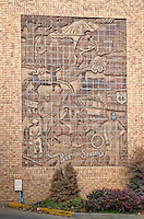 This bas-relif sculpture on the side of the American Bank of Baxter Springs, located on route 66, depicts the history of the town.